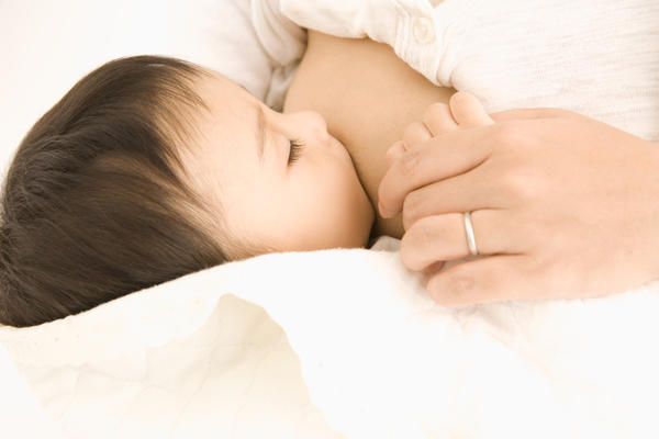 Can the genital herpes virus be passed onto a new born baby through breast feeding?