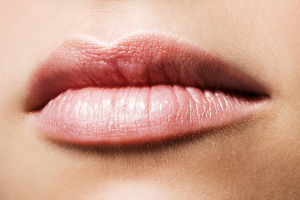 What is the sore on the lip with a white center be?