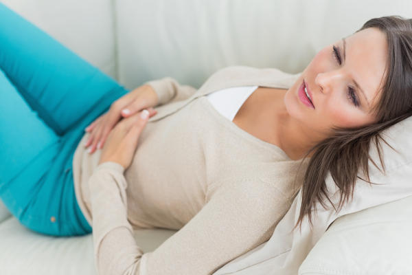 What can cause sharp lower abdominal pain after sex?