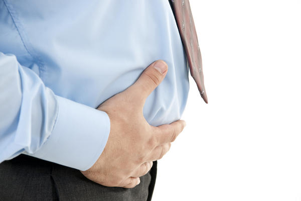 Is it normal to have major bloating a day after a rectal exam w/ lower back pain? Impacted w/ blood in stool, external/internal hemorrhoids, loose stool