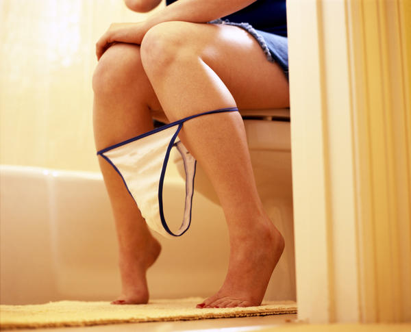 Cause of frequent urination and pain in legs from below the knees?