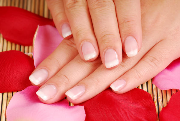What causes the fingernails of an elderly person to seem to disappear?