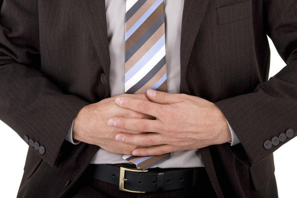 What causes lower abdominal pain in men?