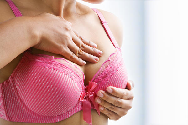 How do I make my breast smaller to reduce back pain without surgery?