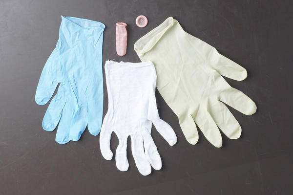 Why do medical staff use latex gloves?