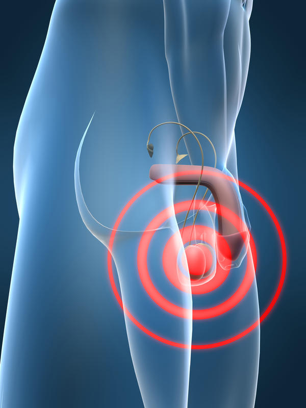What to do if I have pain in lower abdomen and testicle?