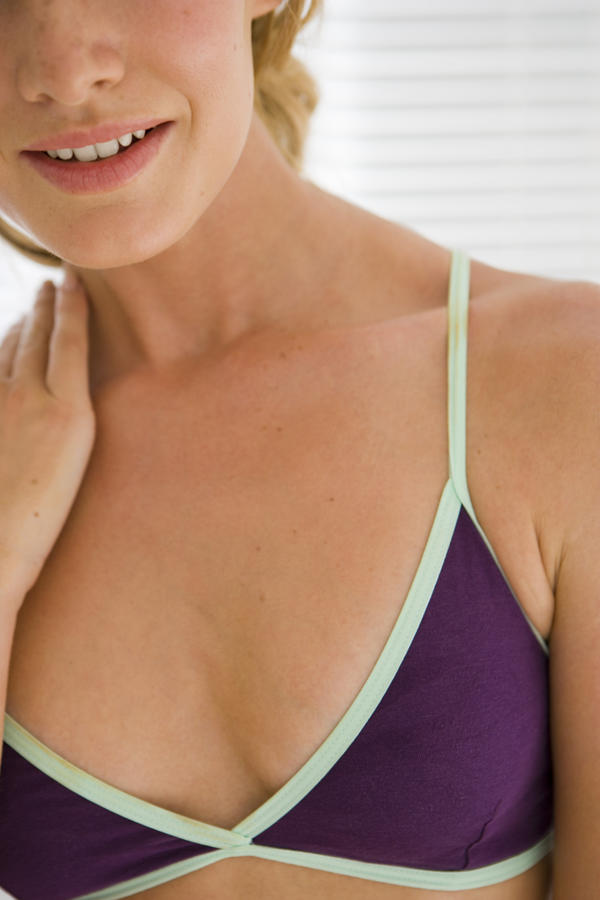 What causes small flat brown spots on areola?