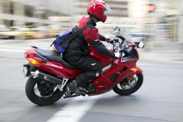 How unsafe is it for a pregnant woman to ride on a motorcycle?