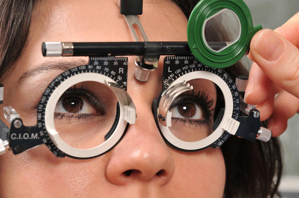 What is the treatment for refractive error that is best and has fewest side effects?