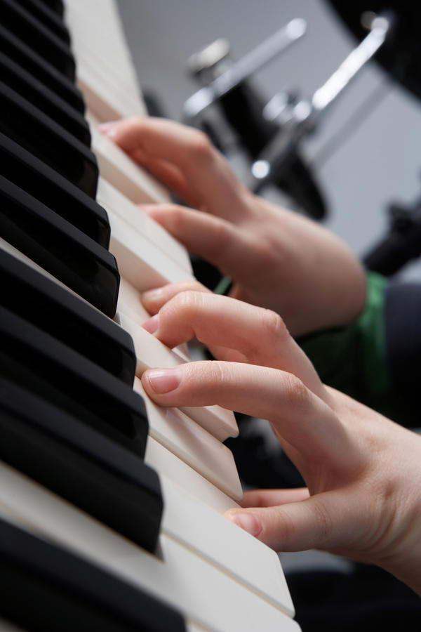 "Are there ANY finger-lengthening exercises? I am an adult with <3"" long fingers who is trying hard to learn guitar and piano."