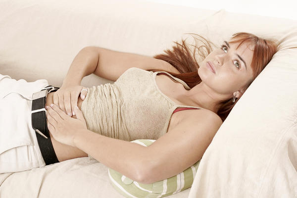 How can one naturally relieve menstrual cramps?
