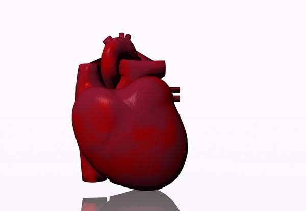 What can cause tiredness, breathlessness on exertion, and an enlarged heart?