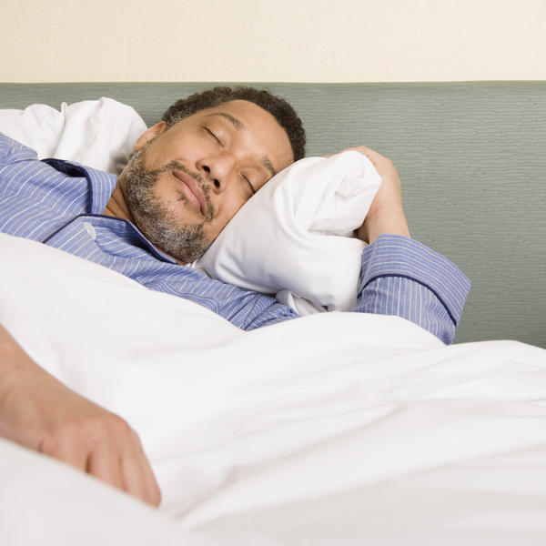 How to sleep with a bad back and hotel bed?