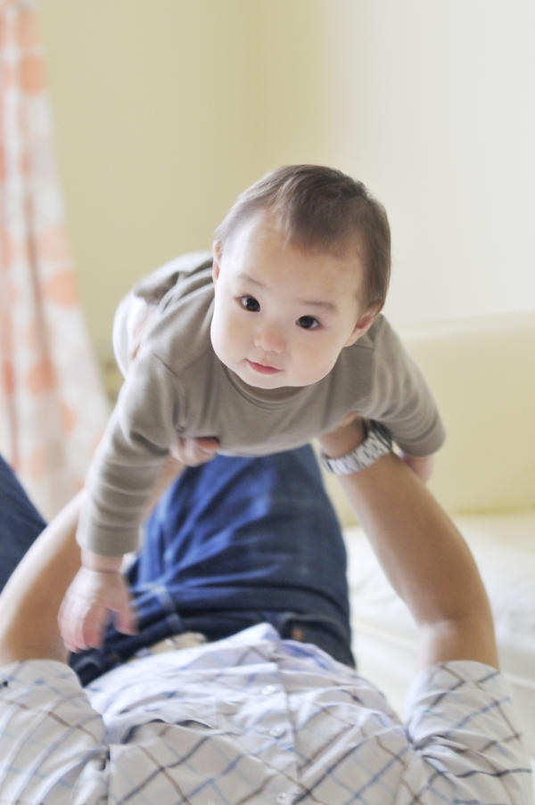 For how long can a 2mnth old baby lay on their stomach? (in time eg minutes/hours)