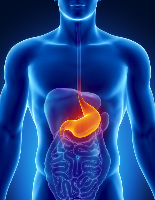 How do acid reflux and a stomach ulcer differ?