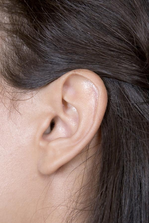 Not too hard small circular bump behind ear... What can it be? It does move around a bit with a bit of pressure...