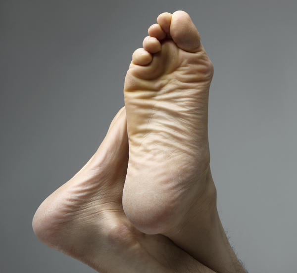 What is the best way to stop pain in my feet?