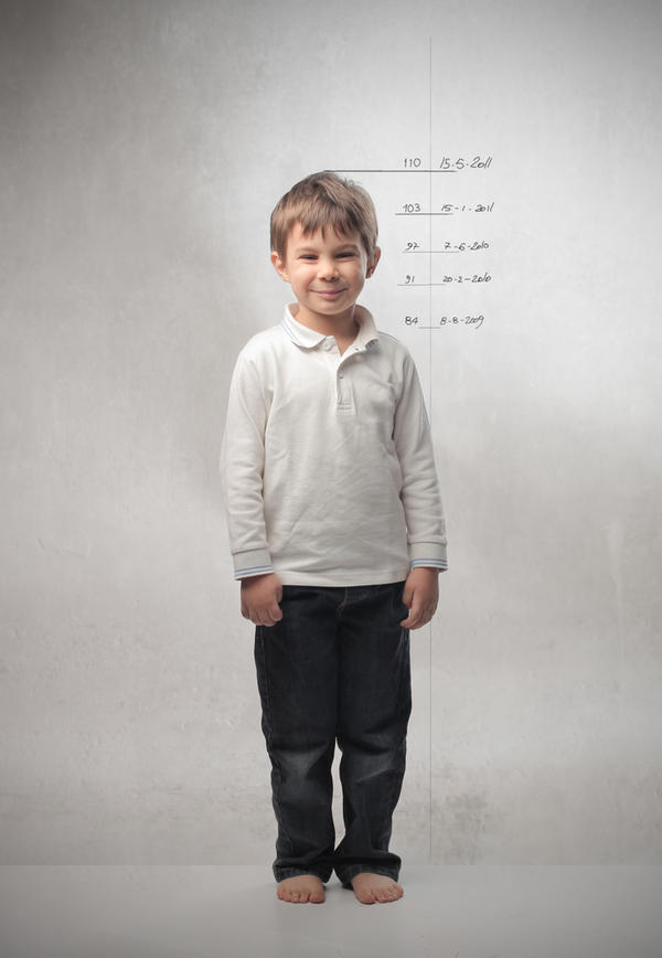 My son height is 122 cm.. And is he will 8 year's old this coming july.. What is proportionate weight  for  him?