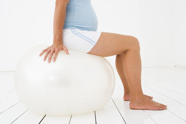 What causes lowback tailbone pain with a cracking joint sound?