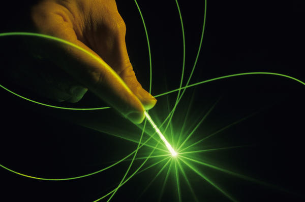 Is green laser pointer radiation dangerous for humans and pets with normal use?