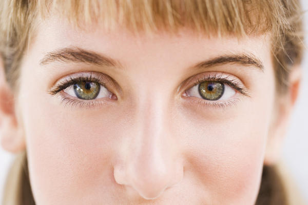 Can pupils stay dilated permanently with atropine?