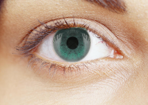 Is it normal to have a very constricted pupil after cataract surgery? What could be the reasons?
