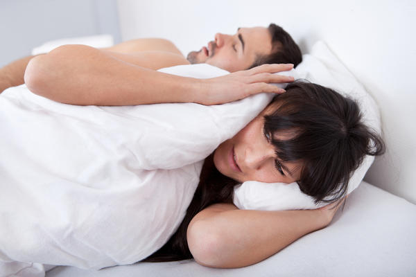 I have trouble sleeping at night. My partner says that I twitch and wake up jolting, like my heart or breathing has stopped. I have asthma and I have been told that I have a murmur. What should I do?