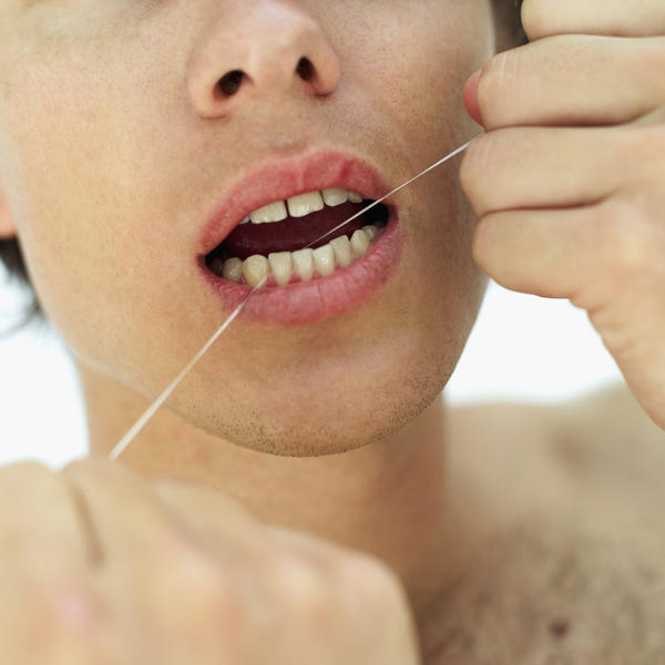 Do I use dental floss before brushing my teeth or the opposite?