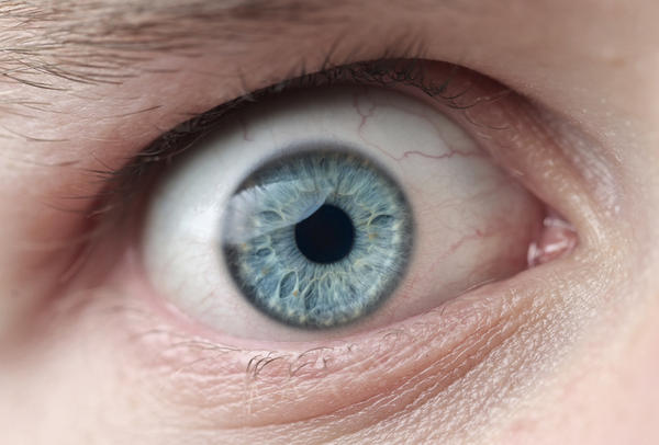 What does it mean when you have white spots behind your eyes?