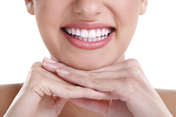 What may be some of the major disadvantages to front teeth veneers?