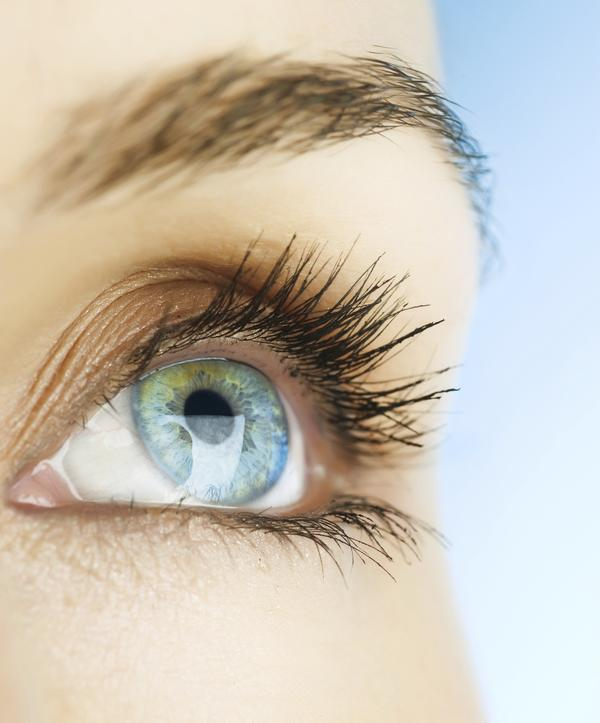 What causes corneal abrasion and how can it be treated?