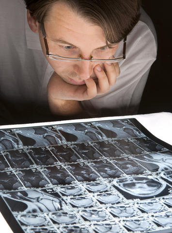 What are the risks of a brain CT scan?