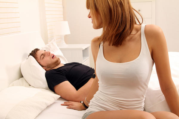 What causes snoring during the time when a person is sleeping?