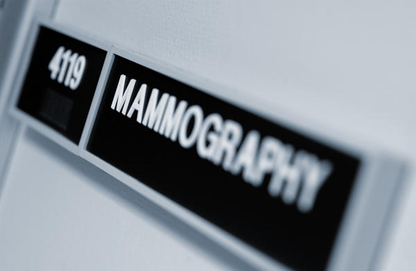 What is overlapping tissue on a mammogram?