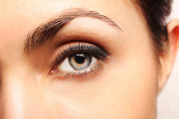 Could a blind pimple cause veins to come out in your eye if it is by your eyebrow or cause it to swell?