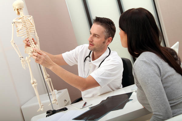 Which type of doctor specializes in the spine?