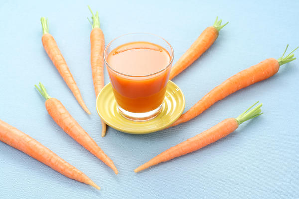 What is the maximum amount of carrot juice could I drink a day? I heard people should not drink more than 4 glasses (8oz each) of carrot juice a day.