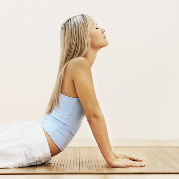 How does yoga help reduce my lower back pain?