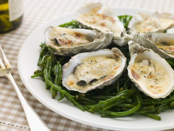 Can you explain if it's safe to eat about 4 ounces of smoked oysters a day?