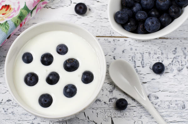 What is in the yogurt that makes the acid subside?