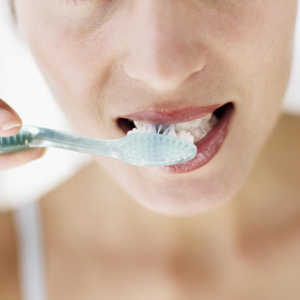 What do dentists do to remove dental plaque?