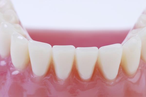 Can there be some cure for dental caries without removing the affected teeth?