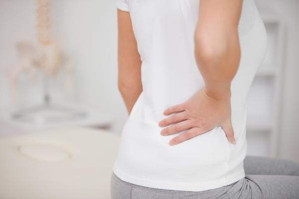 I have lower left back pain and blood in stool, what is it?