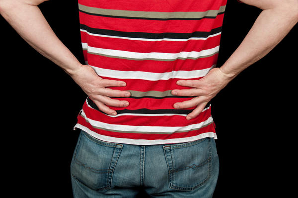 How common is it to have lower back pain after a tetanus or meningitis shot?