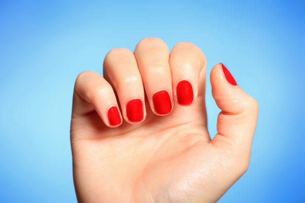 What causes brittle fingernails with vertical ridges?