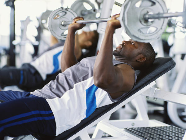 Can you tell me how is dumbbell bench press almost equivalent to barbell bench press?