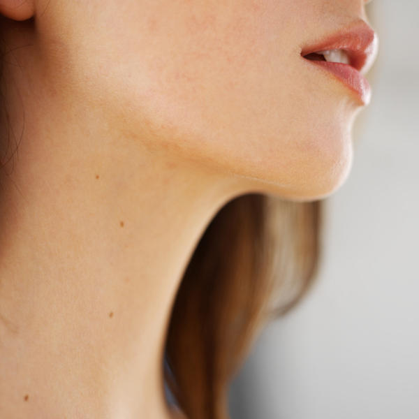 What does a movable lump in the neck just below the right jawline means?