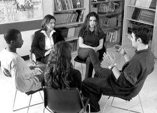 What psychotherapy is best for helping an adult learn social skills?