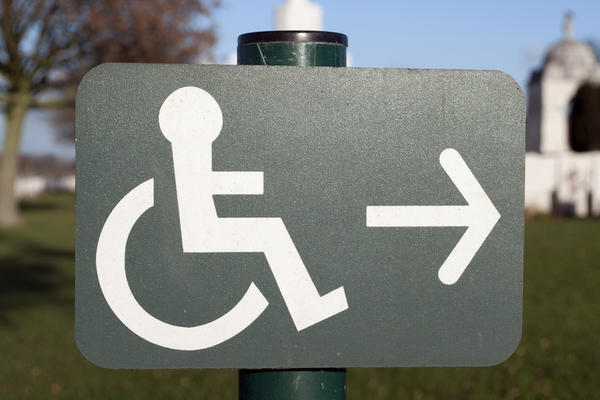What can cause a person have to be to qualify for disability benefits?