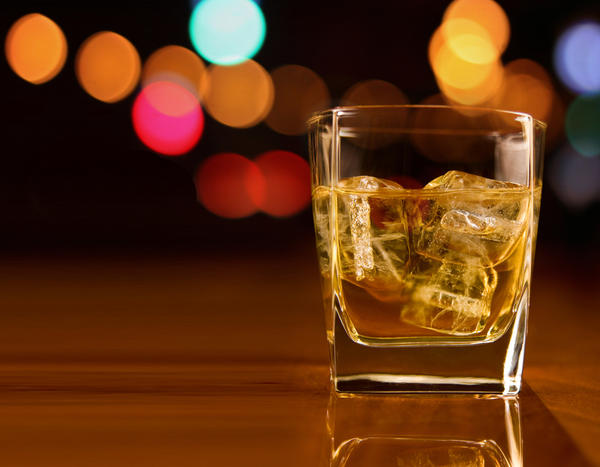 How does alcohol affect the periodontium?